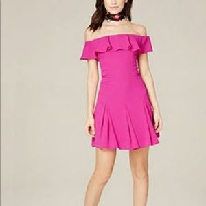 Off shoulder ruffle flounce Bebe dress pink